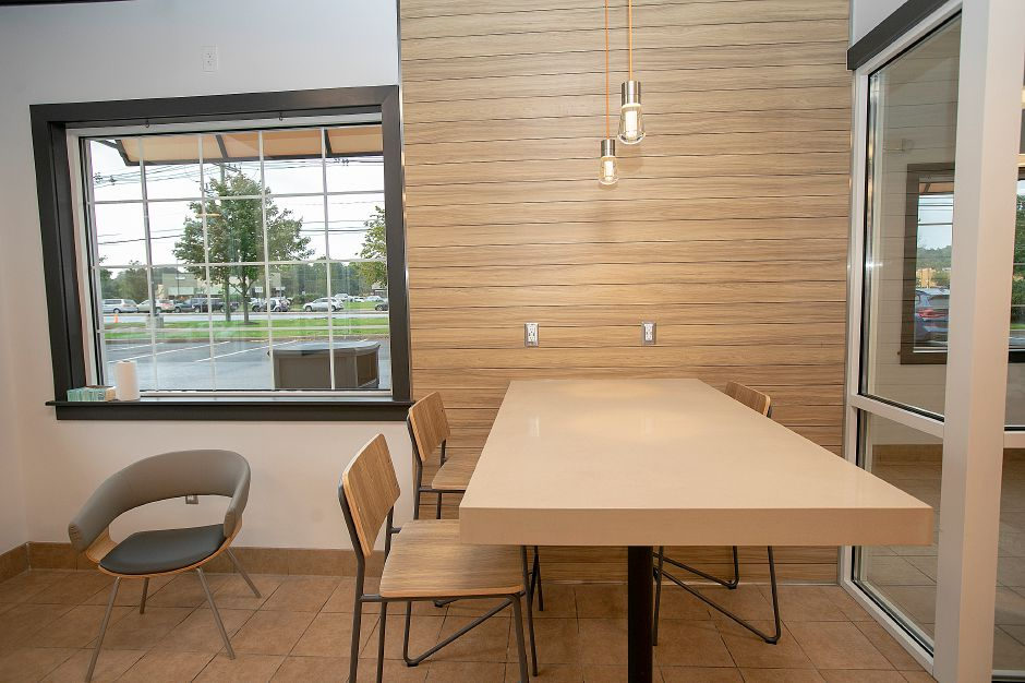 A new community table for patrons at the newly renovated Dunkin