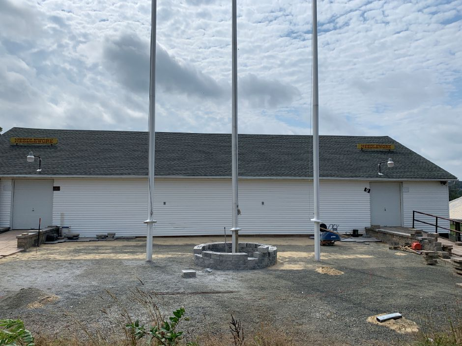 Flagpoles have been positioned and area has been cleared for patio construction at the Everlasting Tribute. Photo by Everett Bishop, Town Times.