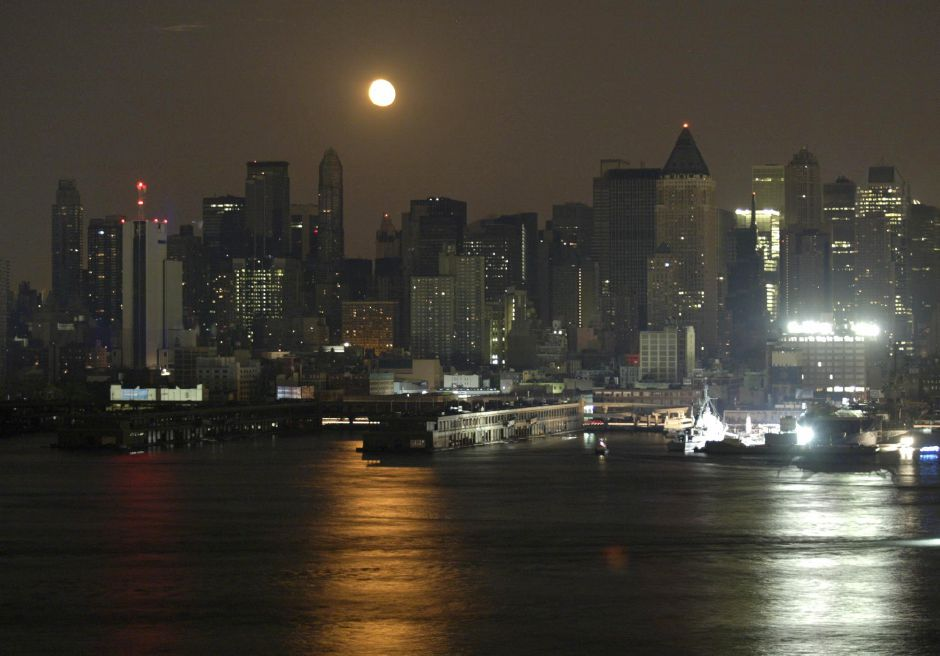 The moon rises over the Upper West side of Manhattan as seen from Weehawken, N.J., Thursday Aug. 14, 2003 A massive power blackout hit U.S. and Canadian cities Thursday. (AP Photo/George Widman)