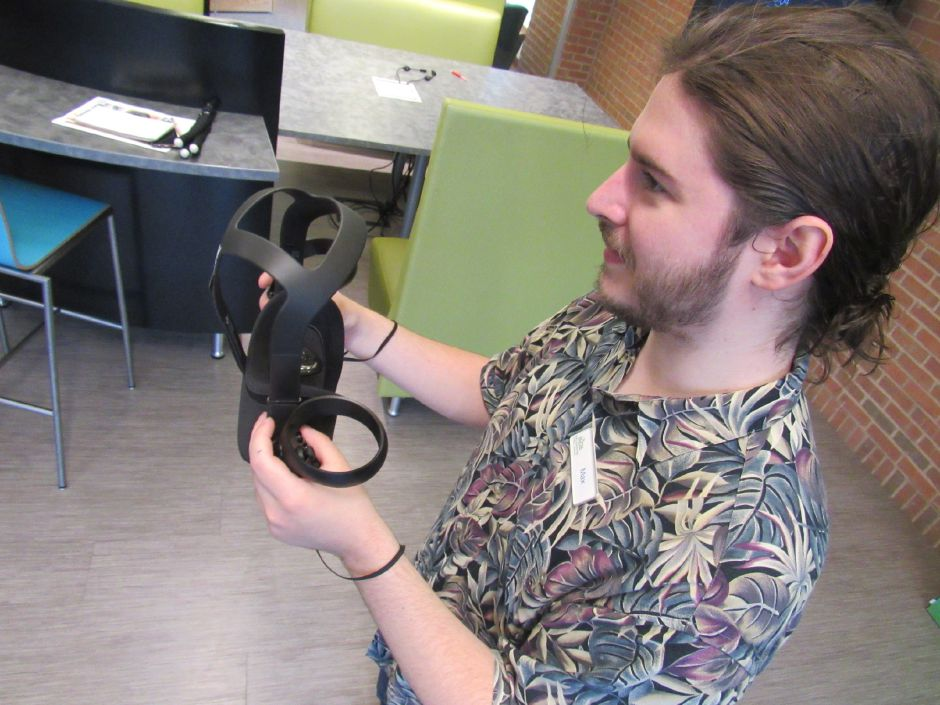 Max Spurr, creative technologies librarian, holds the Oculus Quest,  virtual reality system, in the Collaboratoy. Virtual Summer is a new program for teens available this summer at the Wallingford Public Library.Thursday, June 20, 2019. Photos by Jeniece Roman, Record-Journal.