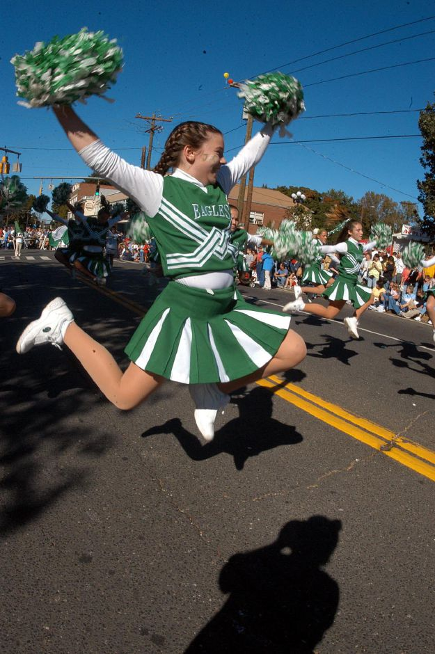 John F. Kennedy Middle School cheerleader Christen Mirando gets some height on her jumps at the annual Apple Harvest Festival held Sunday in Southington.