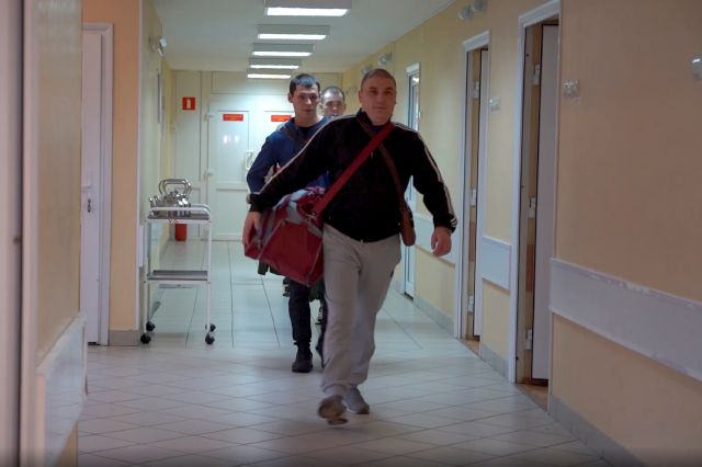In this photo made from footage provided by the Russian Defense Ministry on Wednesday, July 15, 2020, a group of volunteers participating in a trial of a coronavirus vaccine leave their rooms at the Budenko Main Military Hospital outside Moscow, Russia. Russia is boasting that it's about to be the first country to approve a COVID-19 vaccine, but scientists worldwide are sounding the alarm that the headlong rush could backfire. (Russian Defense Ministry Press Service via AP)