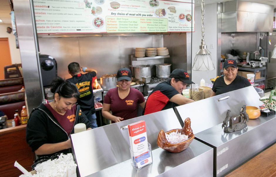 Staff prepare for the lunch rush at Tacos Mi Nacho on Broad Street in Meriden on Friday. Owner Luis Lemus plans to expand the business to an adjacent property. Dave Zajac, Record-Journal