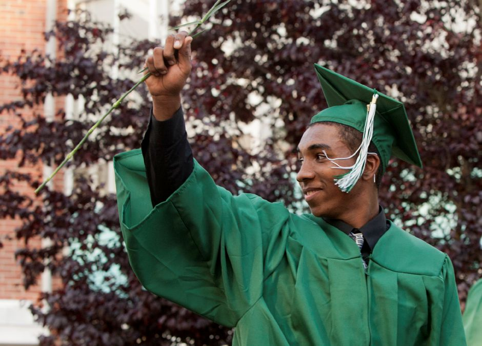 Isaac Matos gestures to the crowd after receiving his diploma during the graduation ceremony at Maloney High School Wednesday evening in Meriden, June 20, 2012. (Christopher Zajac / Record-Journal)
