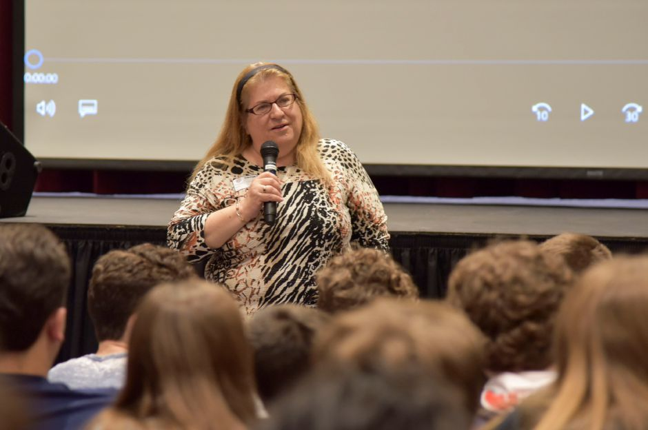 Deputy Director of the CT office of the Anti-Defamation League Marji Lipshez-Shapiro speaks to North Haven Middle School students before they heard from Holocaust survivor Judith Altmann on May 24, 2019. | Bailey Wright, Record-Journal