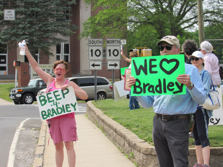 Michelle Dozier (left) and John Randall hold signs for the Community Committee to Save Bradley in a rally in front of the Southington Historical Society in support of Bradley Hospital, Saturday, June. 1, 2019. | Jeniece Roman, Record-Journal.