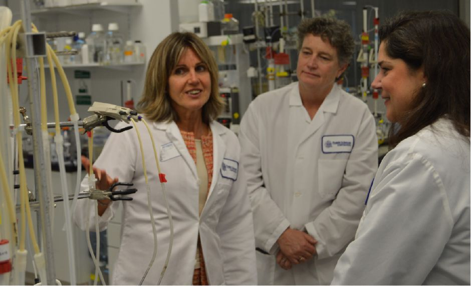 FILE PHOTO: Protein Sciences President Manon Cox, left, explains a piece of equipment to Sen. Beth Bye, of Hartford, and Sen. Dante Barolomeo, of Meriden. Bartolomeo led a group of six female Senate Democrats on a tour of woman-led businesses in Meriden.| Mike Savino, Record-Journal