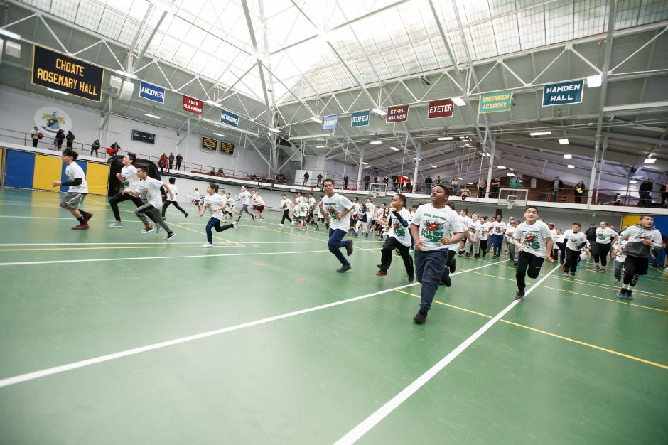 Kids warm up before starting the camp Saturday during the United Way NFL weekend kids camp at Choate Rosemary Hall in Wallingford March 10, 2018 | Justin Weekes / Special to the Record-Journal