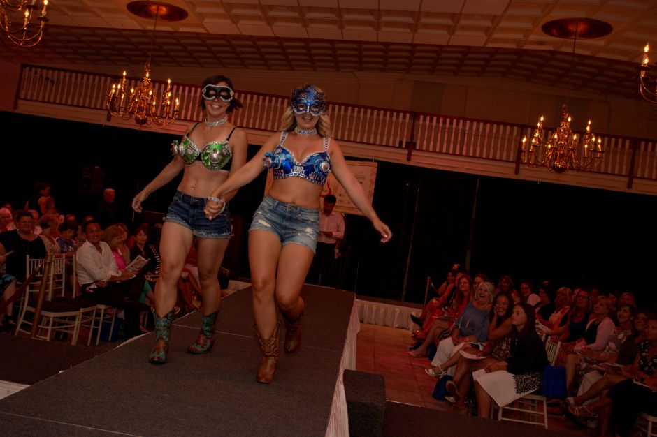 "Katie Robbin, left, and Maggie Zawadzi, right, show off the combo ""Come Fly with Me"" during the Art Bra 2018 Runway Show and Auction Aug. 9, 2018 at the Aqua Turf in Southington. 