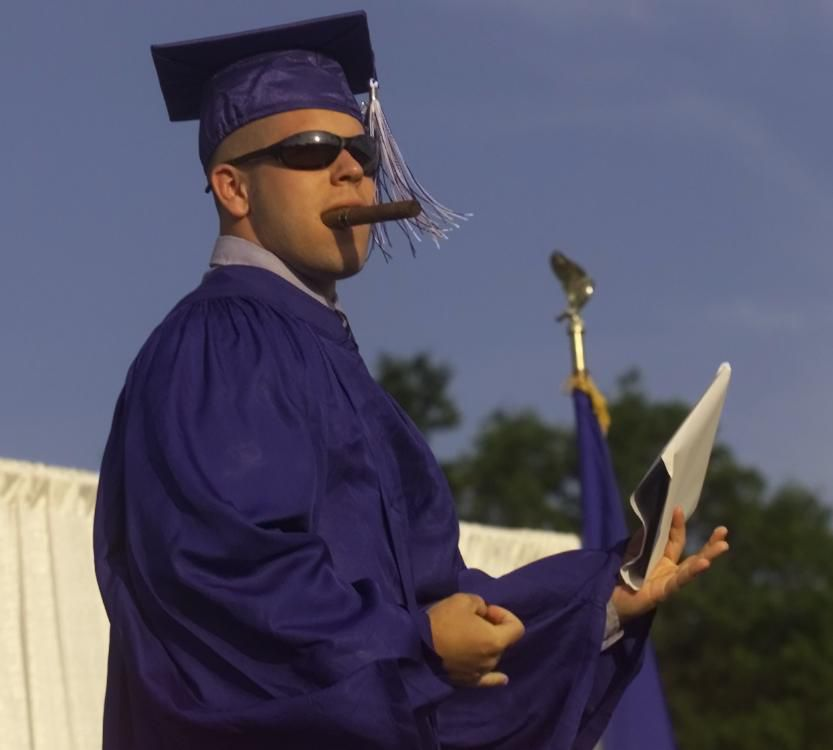 Michael Paul Roy lit a cigar after accepting his diploma during the Lyman Hall graduation Tuesday evening June 20, 2000.