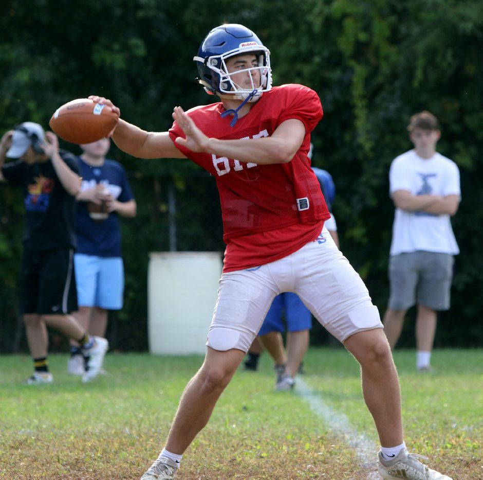 Southington junior quarterback Brady Lafferty airs one out during practice. After opening the season at Conard and Darien, Lafferty and the Blue Knights play their home opener on Sept. 27 against Enfield. | Aaron Flaum, Record-Journal