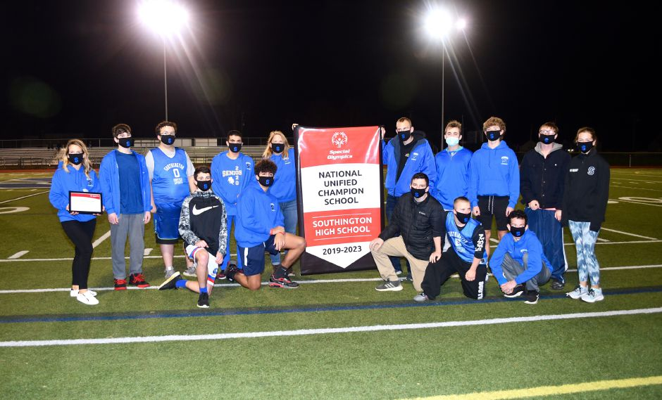 Members of the Southington Unified sports team were honored at a ceremony prior to Thursday night's Southington-Farmington boys soccer game at Fontana Field. Southington High has been nationally recognized as a Special Olympics Unified School. Photo courtesy of Steve Risser