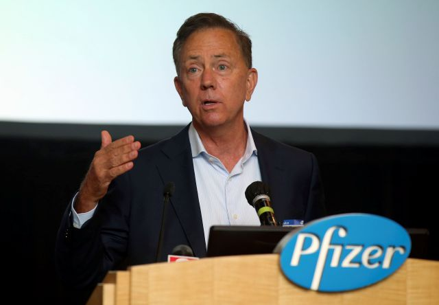 Connecticut Gov. Ned Lamont speaks at a press conference at Pfizer Groton on the companies research to develop a vaccine for COVID-19, Wednesday, July 22, 2020, in Groton, Conn. The federal government has agreed to pay nearly 2 billion for 100 million doses of a potential COVID-19 vaccine being developed by the U.S. drugmaker and its German partner BioNTech. (AP Photo/Stew Milne)