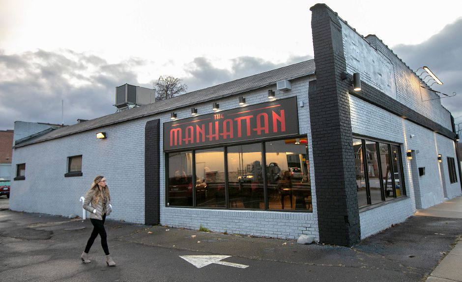 Kristen Sitz, of Middletown, walks to The Manhattan on Eden Avenue in Southington, Fri., Nov. 22, 2019. The 1920's-themed bar offers classic drinks, servers in period attire and full Prohibition-era décor. Sitz will be setting up social media for the Manhattan. Dave Zajac, Record-Journal