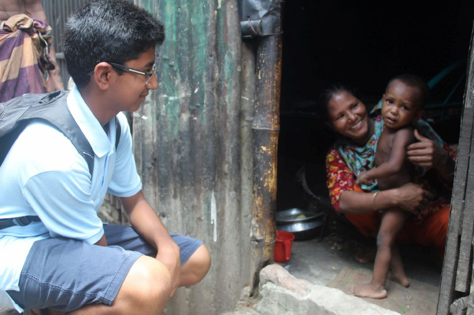 Cheshire Academy sophomore Kavin Kathir spent three weeks abroad, tutoring children in an orphanage in Bangladesh. Here he is seen visiting a family at their home in Dhaka, Bangladesh's capital city. Photo courtesy of Kavin Kathir.