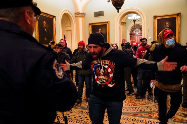 Protesters move in on  U.S. Capitol Police in the hallway outside of the Senate chamber at the Capitol in Washington, D.C., on Wednesday, Jan. 6. Manuel Balce Ceneta, Associated Press