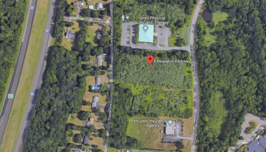 East Side Auto Transport submitted a site plan application to construct a 9,720 square-foot building on a 3-acre vacant property at 6 Research Parkway in Wallingford. | Google Maps