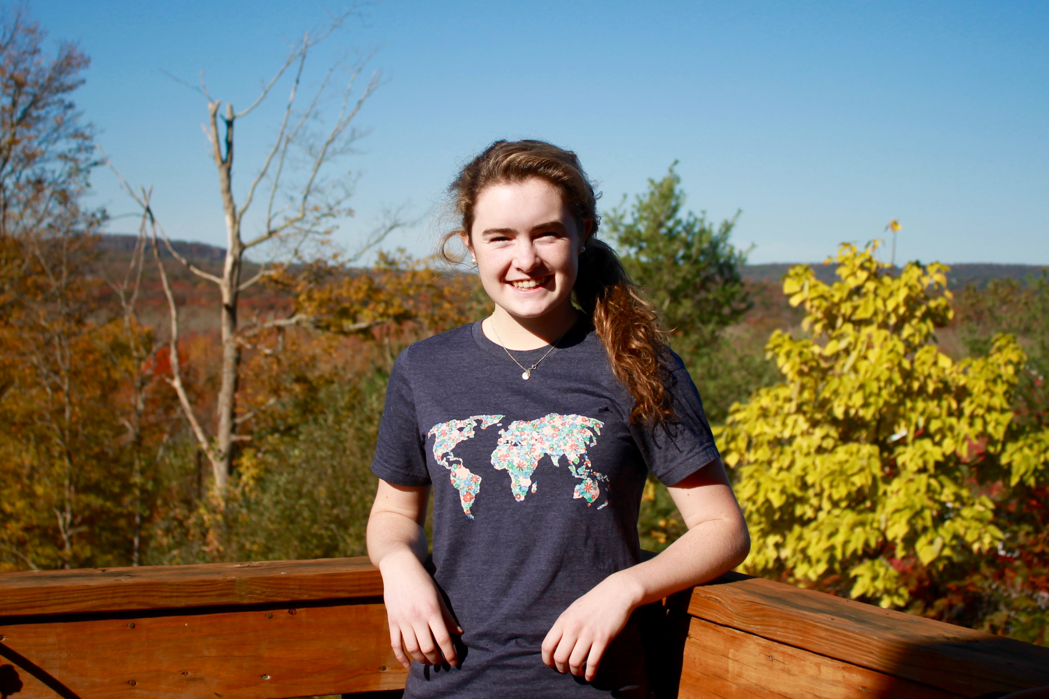 Durham teenager Kaitlyn Leahy launched a t-shirt business this month to help in the fight against hunger. Leahy is pictured wearing one of her Heart over Hunger shirts. | Mark Dionne, Town Times