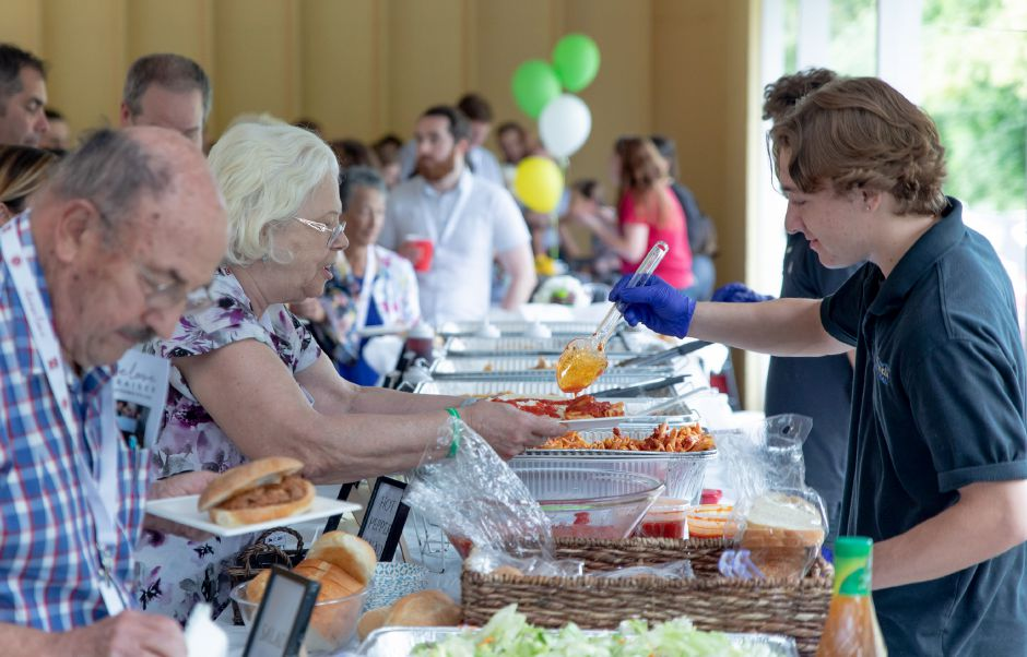 Maureen Embler is served dinner at a Choose Love fundraiser at the Meriden YMCA Mountain Mist Day Camp on Sept. 5, 2019. The nonprofit, which split the proceeds with Meriden Public Schools, promotes emotional education in youth with the aim of ending school shootings nationally. | Devin Leith-Yessian/Record-Journal
