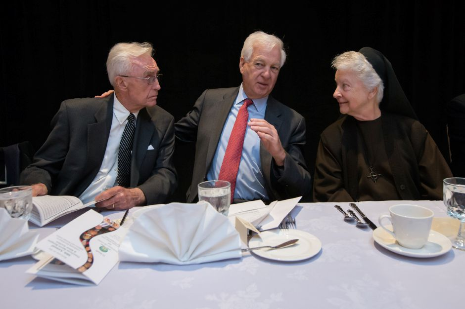 UConn's Dee Rowe, left, college basketball broadcaster Bill Raftery and Mother Shaun Vergauwen of the Franciscan Life Center chat during the 30th Franciscan Sports Banquet and Silent Auction in 2015 at the Aqua Turf Club. Rowe, who died last Sunday, was a fixture at the annual Franciscan event. Record-Journal file photo