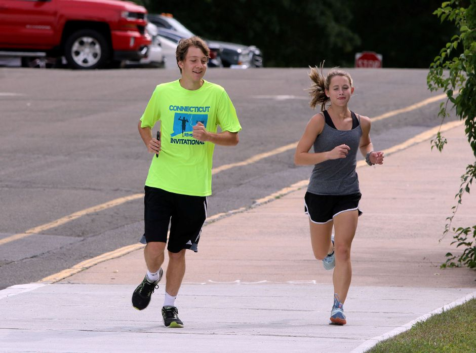 Derrick Arnold and Lizzie Brown hit the course during a recent Sheehan cross country practice. | Aaron Flaum, Record-Journal