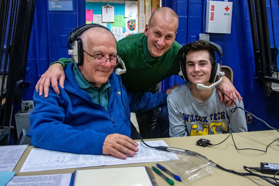 All in the Family: Three generations of the DeMaio family were in Joseph Schiopucie Gymnasium on Tuesday night for the Guilford-Wilcox Tech boys basketball game. Guilford coach Jeff DeMaio (center) coached against his son Nathan (right) and the Wilcox Indians. George DeMaio (left), father to Jeff and grandfather to Nathan, called the game for WELI. See more photos online at myrecordjournal.com/sports Aaron Flaum, Record-Journal