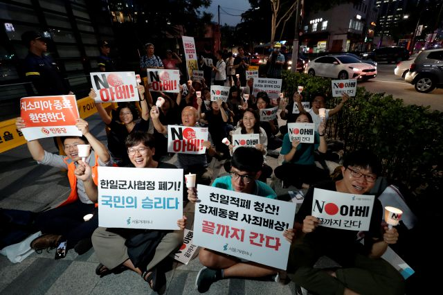 South Korean protesters react during a rally about the General Security of Military Information Agreement, or GSOMIA, in front of Japanese embassy in Seoul, South Korea, Thursday, Aug. 22, 2019. South Korea will stop exchanging classified intelligence on North Korea with Japan amid a bitter trade dispute, an official said Thursday, a surprise announcement that is likely to set back U.S. efforts to bolster security cooperation with two of its most important allies in the Asian region....