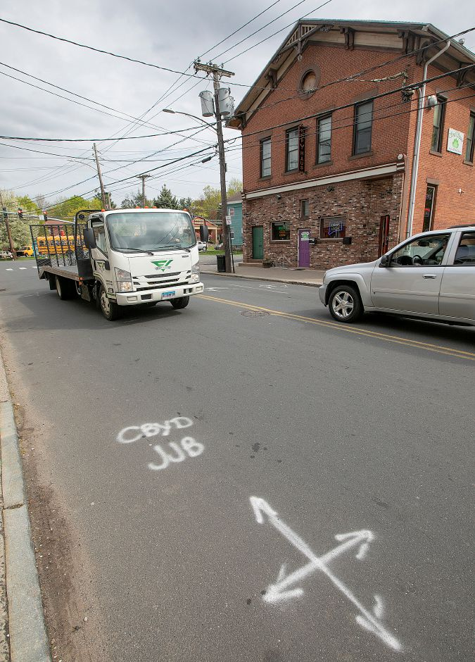 """Call Before You Dig"" markings on West Main Street Plantsville are seen here on Thursday. Water main replacement work will complicate traffic in downtown Plantsville for about three months starting Monday."
