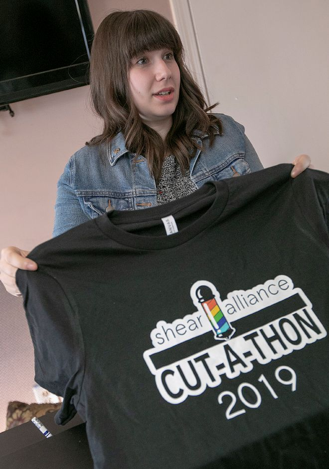 In this file photo, barber Cass Quinn shows a t-shirt for the first Shear Alliance cut-a-thon this past spring. The organization is planning its second event in November. | Dave Zajac, Record-Journal