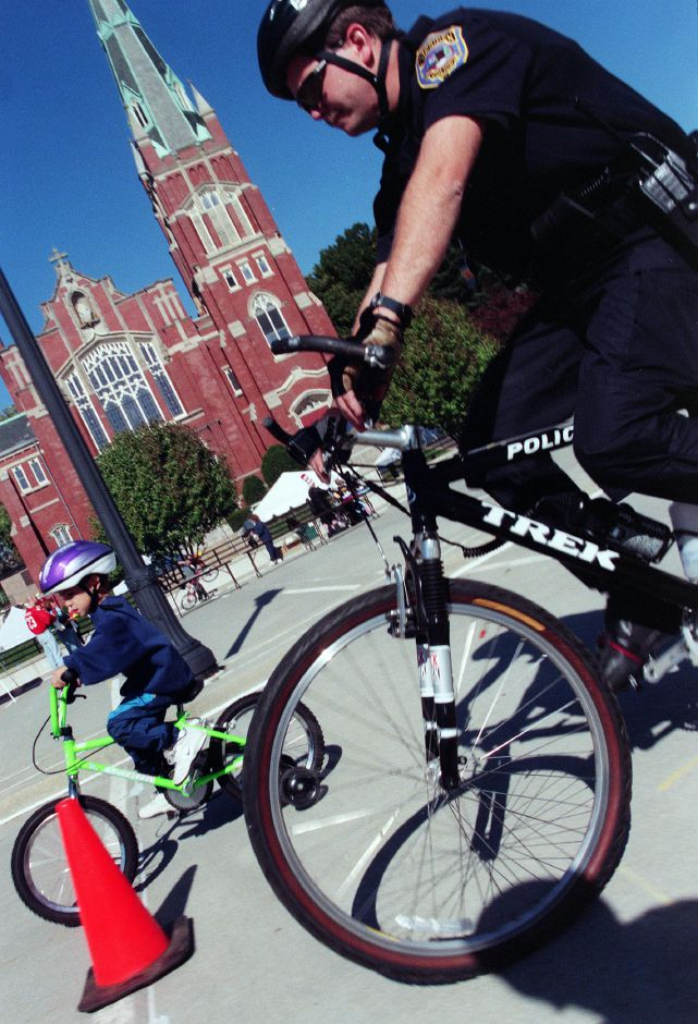 Meriden Police Officer Stanley Zajac, left, and his son Marcel Zajac ride together douring bike rodeo Oct. 16, 1999