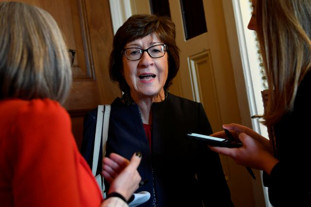 In this Jan. 15, 2020, photo, Sen. Susan Collins, R-Maine, talks to reporters on Capitol Hill in Washington. In the dawn of what may be her toughest reelection fight, veteran Collins has parachuted into familiar terrain _ the pressure-packed middle of an issue, this time the impeachment of President Donald Trump. (AP Photo/Susan Walsh)