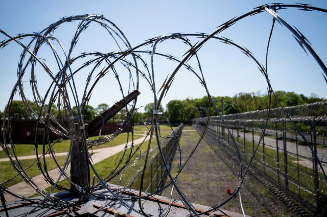 Razor wire surrounds the perimeter fencing at the former Arthur Kill Correctional Facility, Tuesday, May 11, 2021, in the Staten Island borough of New York. The facility was purchased by Broadway Stages in 2017 and has been transformed into a film and television studio. Much of the prison was preserved as a set, lending authenticity to scenes in productions. Five other sound stages are being built on the 69-acre site, giving production companies the ability to shoot entire projects. (AP...