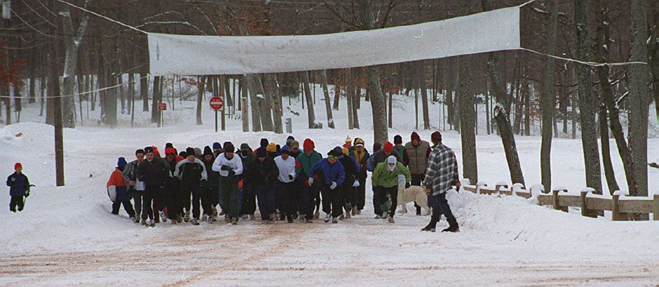 Despite the earlly morning snow the runners still partakes in the 32nd Annual Bernie Jurale Memorial Tradition Run at Hubbard Park in Meriden January 21, 2001.