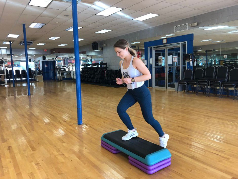 Kristen Dearborn demonstrates incorporating calisthenics, such as step ups, into your workouts regularly. |Kristen Dearborn, Special to Record-Journal