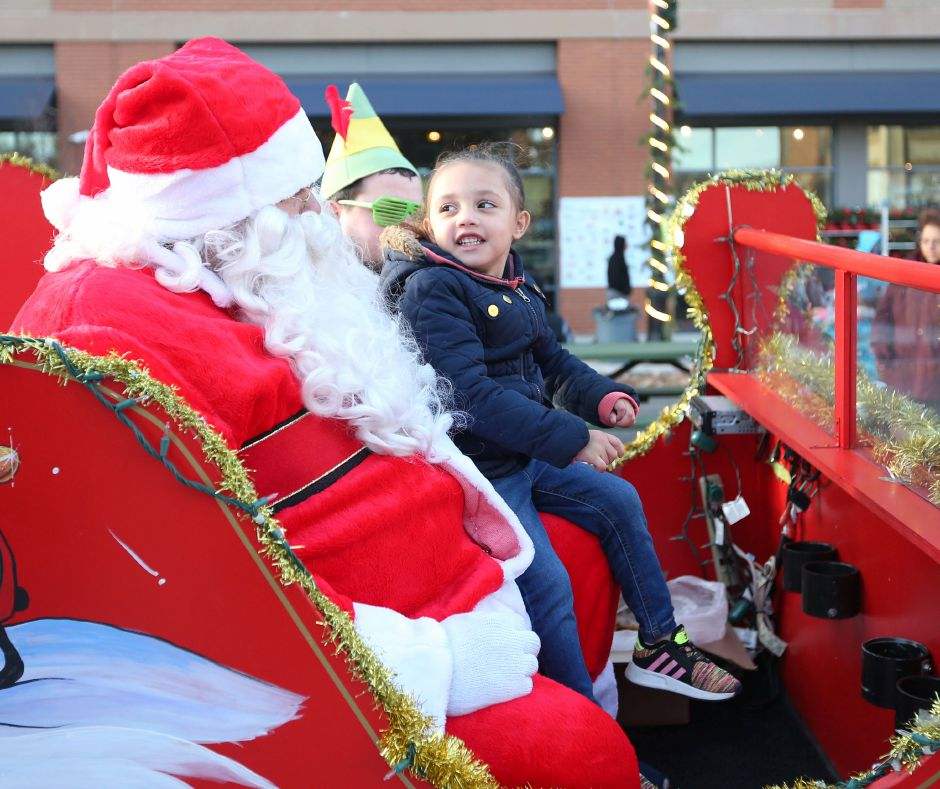 Aliviah Hughes, 3, of Meriden, talks with Santa in his sleigh outside of the Meriden train station during the annual Yulefest on Saturday. For more photos, visit www.myrecordjournal.com.Emily J. Tilley, special to the Record-Journal.