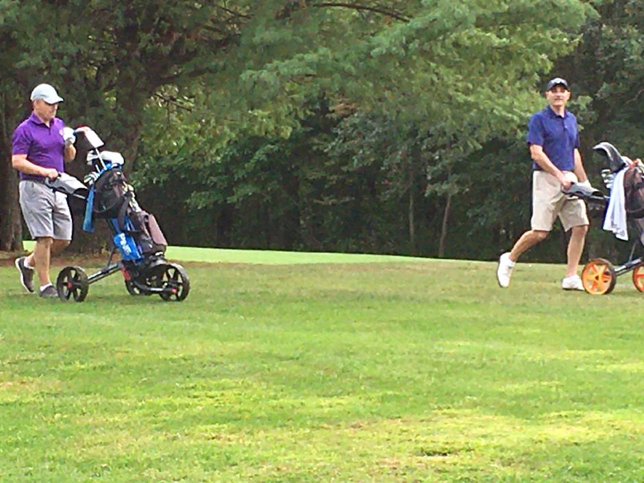 Kyle Zimmerman, left, and Brett Zimmerman, right, walk off the seventh tee box during Sunday's George Hunter Tournament at Hunter Golf Course. Brett Zimmerman shot a 1-over 72 to win by three strokes. Photo courtesy of Del Weston