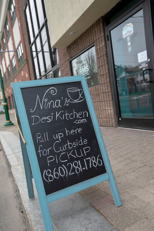 Curbside pickup available at Nina's Desi Kitchen, a new restaurant at 26 North Main St. Southington, Fri., Apr. 17, 2020. The restaurant focuses on Pakistani food, mixing a variety of very traditional regional dishes with newer, unique ones. Dave Zajac, Record-Journal