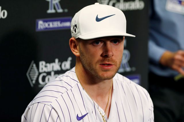 Colorado Rockies shortstop Trevor Story responds to a question during a news conference as part of the team