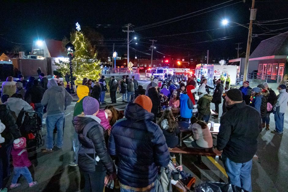 Glowing at the corner of Main Street and Farmington Avenue, Berlin Christmas tree was lit in a ceremony on Nov. 30, 2019. The tree was moved to Main Street after around three decades of being set up at Veterans Memorial Park. | Devin Leith-Yessian/Berlin Citizen