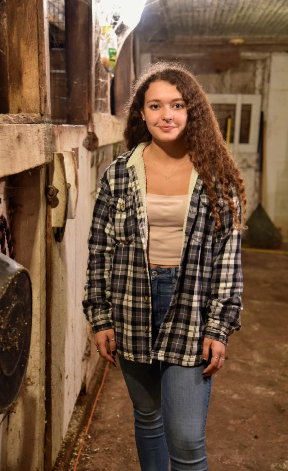 Grace Strillacci, 18, poses at the farm where she takes care of her two cows in Southington, on Thursday, September 20, 2018. | Bailey Wright, Record-Journal