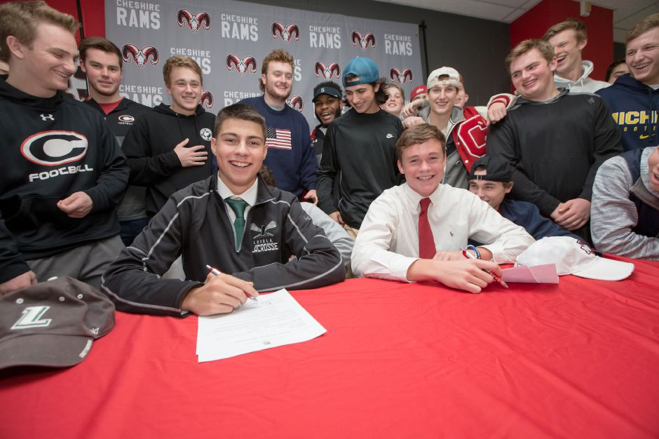 Cheshire lacrosse players Jack Raba, left, and Tim Hoynes signed their National Letters of Intent on Wednesday at Cheshire High School. Raba is heading to Loyola-Maryland and Hoynes is headed to UMass. | Justin Weekes / For the Record-Journal