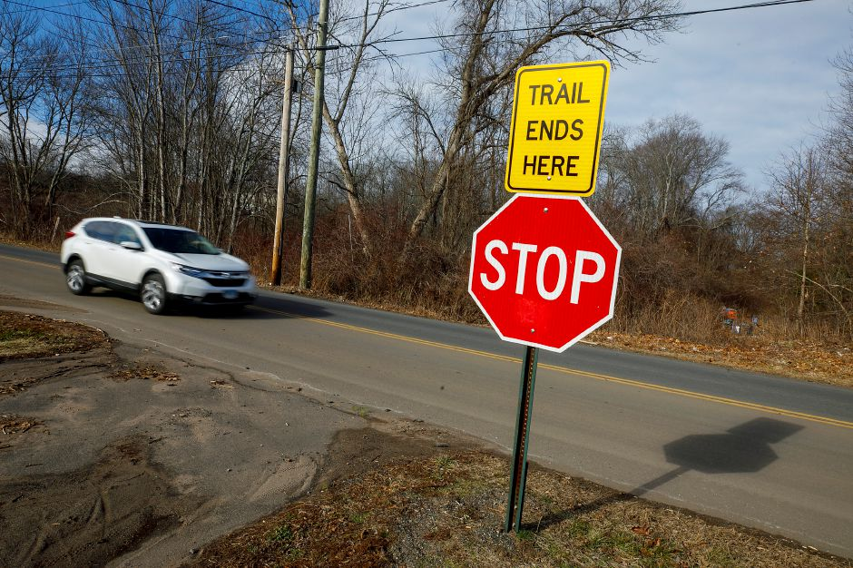 A motorist on Lazy Lane passes the end of the Farmington Canal Heritage Trail in Southington on Wednesday.