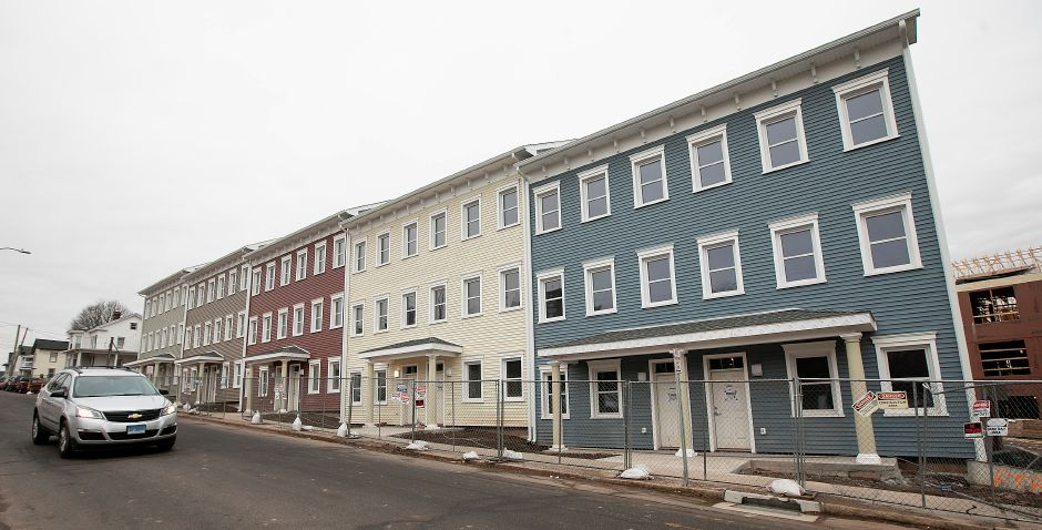 Construction continues on an 81-unit, mixed-income housing development along Crown Street in downtown Meriden.