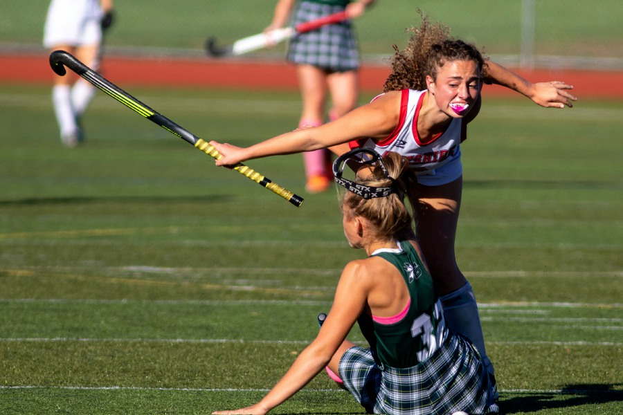 Cheshire's Sophie Vagts collides with Guilford's Delaney Victor during the first quarter of Thursday's SCC field hockey showdown at Cheshire High School. Vagts scored twice in Cheshire's 3-1 victory that snapped Guilford's 33-game winning streak. Aaron Flaum, Record-Journal