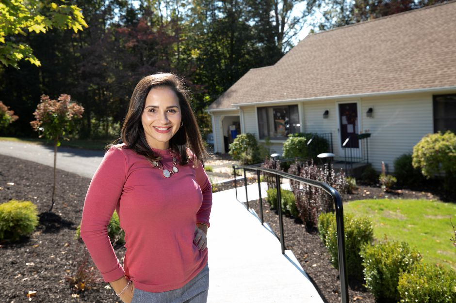 Christina Caro, LPN, director of Franciscan Ever There Care in Meriden, poses for a photo outside her office at 130 Beverly Drive in Meriden, across from  Franciscan center.