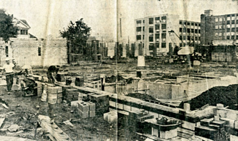 The Kennedy Building in the background overlooks workmen as they lay brick for the library under construction on Miller Street. The view above, looking northwest, shows most of the brickwork completed, Sept. 1971.