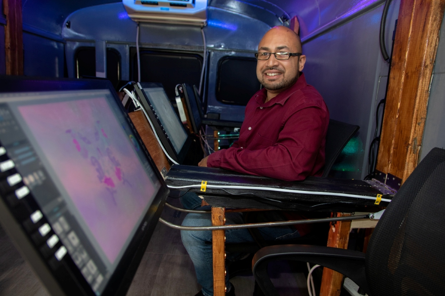 Artist Apollo Maldonado shows the mobile digital art studio he made from a bus on Wednesday, October 21, 2020, at Hubbard Park in Meriden. The bus can hold up to six people for art classes or a digital art night out. Aaron Flaum, Record-Journal