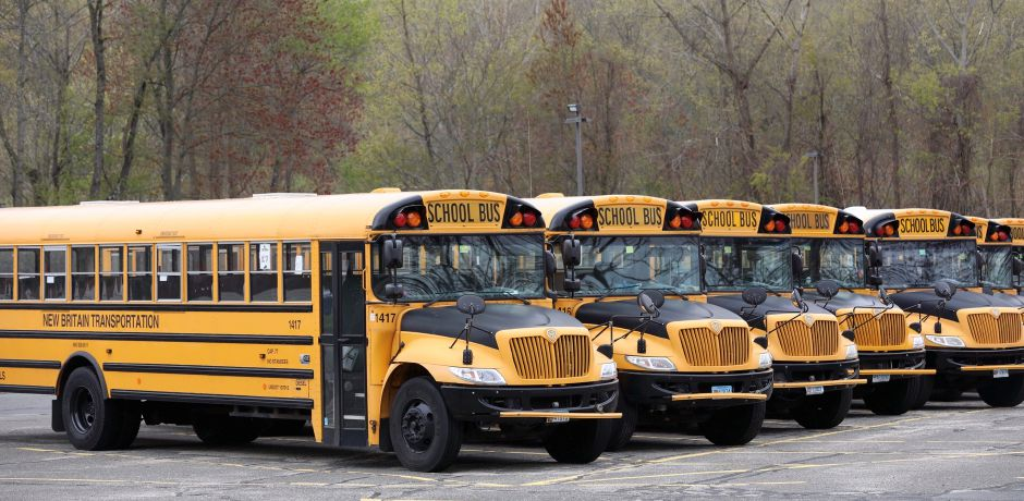 School buses sit parked at New Britain Transportation, 1748 N. Broad St., in Meriden on Wednesday. Dave Zajac, Record-Journal
