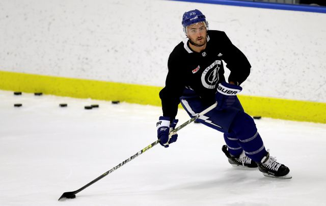 FILE - In this Sept. 13, 2019, file photo, Tampa Bay Lightning defenseman Kevin Shattenkirk (22) looks for an open teammate during the first day of NHL hockey training camp in Brandon, Fla. As NHL teams move toward paying their stars more money and relying on young players to fill the gaps, hockey's middle class is being squeezed out. Veterans like 2018 Washington Capitals playoff hero Devante Smith-Pelly are finding it increasingly difficult to land guaranteed contracts and are...