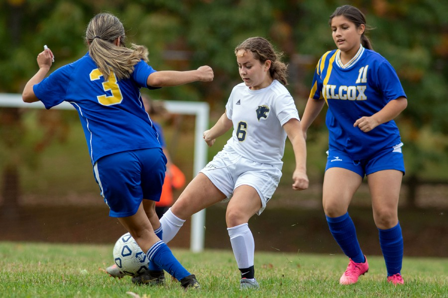 Platt's Avila Kaylani and Wilcox Tech's Alexa Sanchez battle for the ball as the Katherine Arichavala comes to assist during Monday's junior varsity game at Wilcox Tech. With low roster numbers, Platt decided to shift to JV this fall in hopes of regenerating its girls soccer program. Wilcox Tech did the same with football in 2017. Aaron Flaum, Record-Journal
